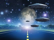 Space travelers. Full moon seen from earth. Flying saucers over the highway Stock Image