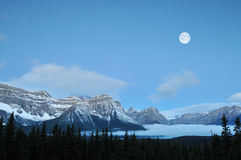 Full Moon set over the Canadian Rockies Stock Photo