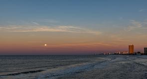 Full moon setting over gulf of mexico royalty free stock images