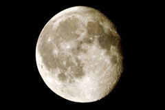 Moon with craters. Almost full moon with shadows showing craters at horizon royalty free stock photos