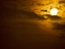 Full moon. The full moon shining in the night sky shined with the cloud cover looked somber Royalty Free Stock Photos