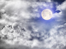 Full moon in sidereal cloudy sky Stock Images