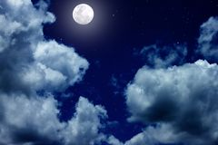 Full moon on the sky. The bright night sky with full moon and white cloud stock photo