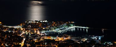 Panoramic view of the city. Full moon spectacle over city of Kavala, Greece stock images