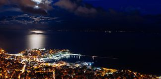 Panoramic view of the city. Full moon spectacle over city of Kavala, Greece stock photography