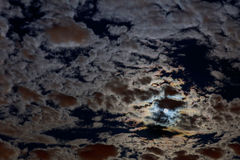 Full moon in a starry night with some clouds Stock Photos