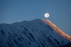 Full moon during a sunrise on the background of snow-capped in Himalayas mountains in Nepal Stock Photography
