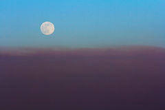 Full moon at sunset Royalty Free Stock Photo
