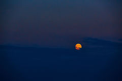Full moon at sunset. The full moon at sunset. Summer night Royalty Free Stock Images