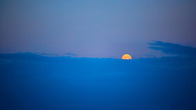 Full moon at sunset. The full moon at sunset. Summer night Stock Photography