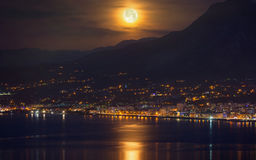 Full moon, supermoon with reflection in sea Royalty Free Stock Image
