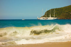 A full moon surge in the caribbean. Waves crashing onto a beach in the windward islands stock photos