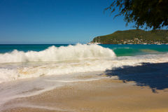 A full moon surge in the caribbean. Waves crashing onto a beach in the windward islands stock images