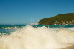 A full moon surge in the caribbean. Waves crashing onto a beach in the windward islands stock photo