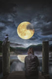 Full moon. Thinking alone in the moonlight Royalty Free Stock Images