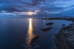 Full moon timid on the coast Royalty Free Stock Photography