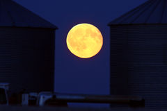 Full moon between two grain vaults Royalty Free Stock Photography