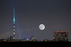 Full moon under city Stock Photography