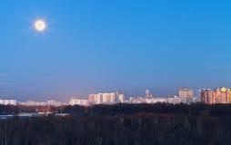 Full moon under city Stock Image