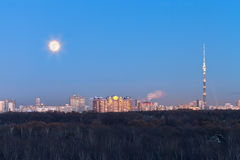 Full moon under city Royalty Free Stock Photography
