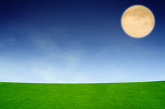 Full moon under the spring fields Royalty Free Stock Images