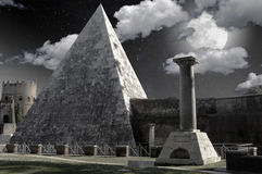 Full moon up the pyramid. Full moon on the square of the egyptian pyramid in Rome royalty free stock photography