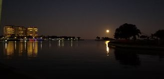 Full moon on the water royalty free stock photo