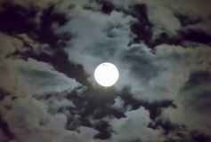 Beautiful full moon and white cloudy sky background in the midnight sky background, moonlight on Halloween night without stars. Full moon and white cloud sky in Royalty Free Stock Photos
