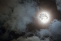 Full moon and white clouds at night Stock Image
