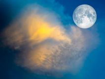 full moon yellow cloud in the blue sky Royalty Free Stock Photo