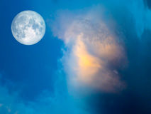 full moon yellow cloud in the blue sky Stock Photo