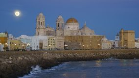 Full Moonrise Over the Cathedral Cadiz Spain stock photo