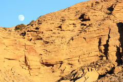 Full moonrise over desert rocks Royalty Free Stock Image