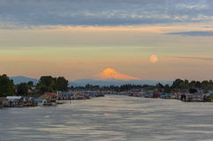 Full Moonrise over Mount Hood along Columbia River in Portland Oregon. Full moonrise over Mount Hood and floating boat houses along Columbia River in Portland Royalty Free Stock Photos
