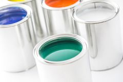 Full of multicolored paint cans on white table.  royalty free stock photos