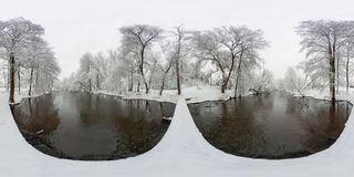 Full 360 panorama in spherical equirectangular projection. Skybox for VR content. Trees in the frost on the bridge by the river stock photo