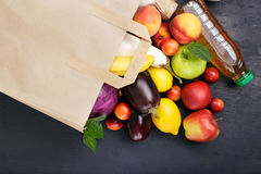 Full paper bag with different food Royalty Free Stock Photography