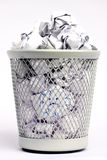 Full paper bin with bad Idea. Silver colored metal paper bin full of white paper pieces rolled into balls and a bad idea Royalty Free Stock Photography