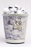 Full paper bin. Silver coloured metal paper bin full of white paper pieces rolled into balls Stock Photo