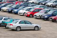 Full parking lot. Row of cars on parking lot Royalty Free Stock Photos
