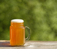 Full pint of golden beer ready to drink outdoors Royalty Free Stock Photography