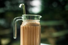 A full pitcher of indian chai masala tea royalty free stock photography