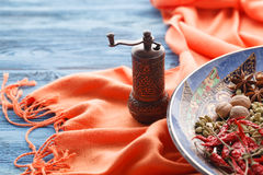 Full plate of asian spices with chilli on blue table Stock Photo