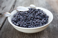 Full plate of Blueberries on wooden table Stock Images