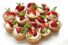 Full  plate of delicious fresh berries mini-cakes Royalty Free Stock Photography