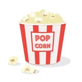 Full popcorn bucket. Classic box of red and white popcorn. Vector illustration isolated on white background Stock Image