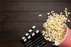 Full popcorn bucket. On a dark background stock image