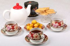 Free Full Porcelain Teacups With Hot Tea And With Floral Pattern, Biscuits And Plate With Wild Apricots Royalty Free Stock Photo - 120950505