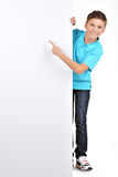 Full portrait of  boy pointing on white banner Royalty Free Stock Image