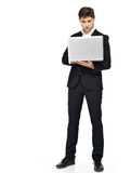 Full portrait of businessman working on laptop Stock Images